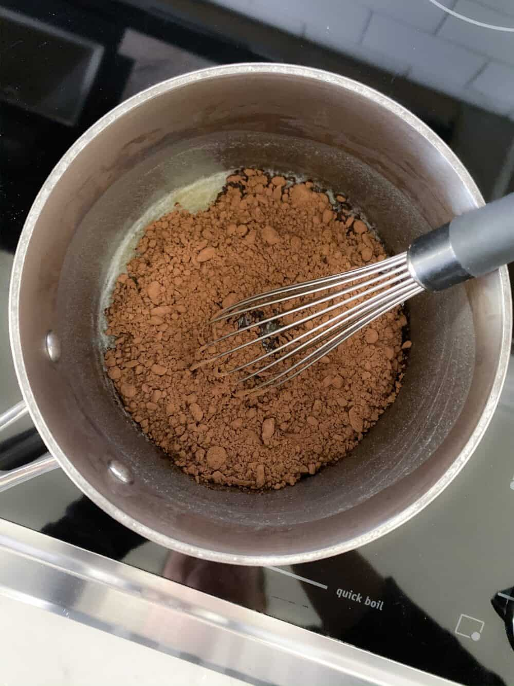 chocolate in mixing bowl for homemade chocolate frosting