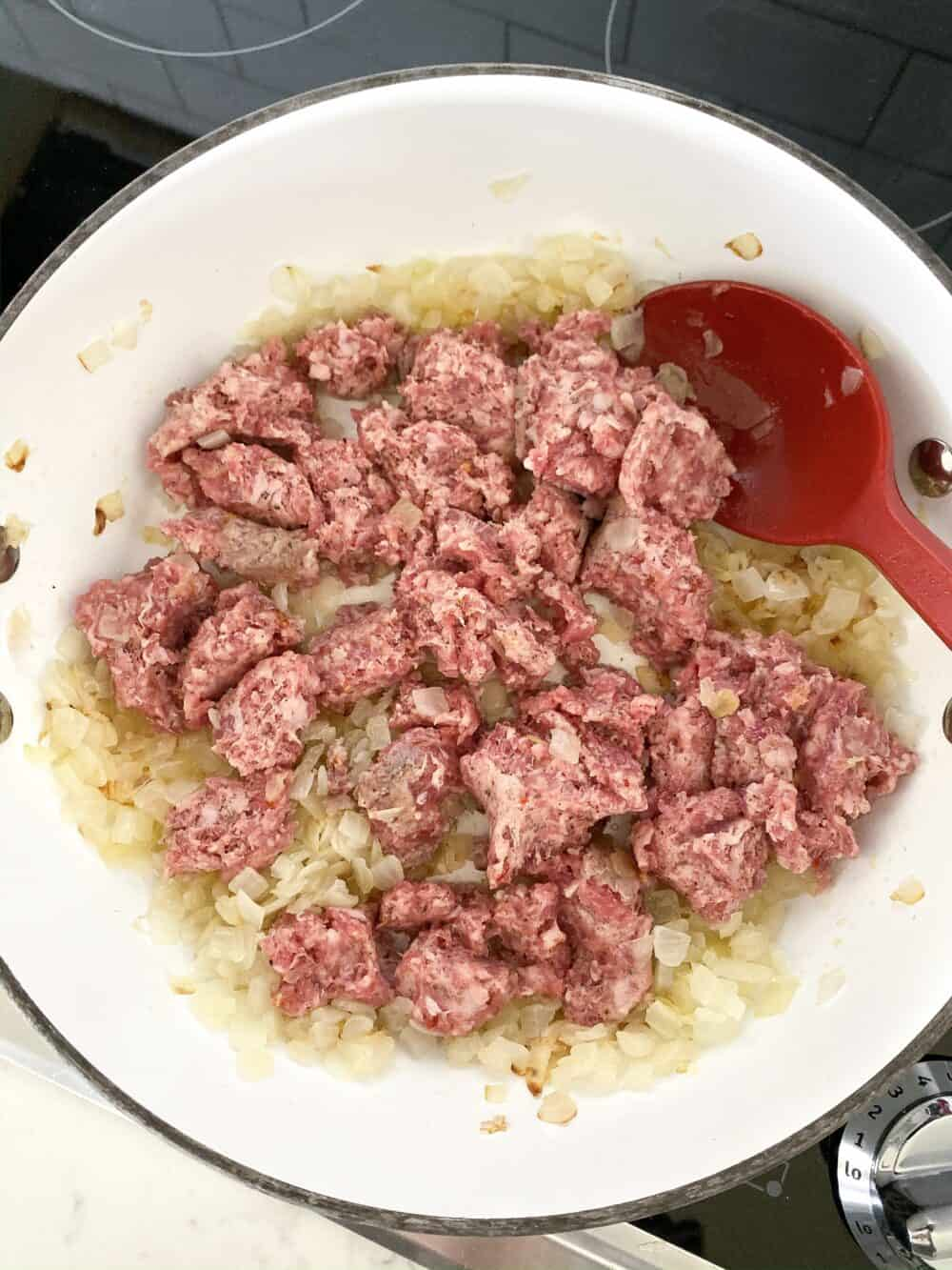 browning sausage in pot for lasagna soup