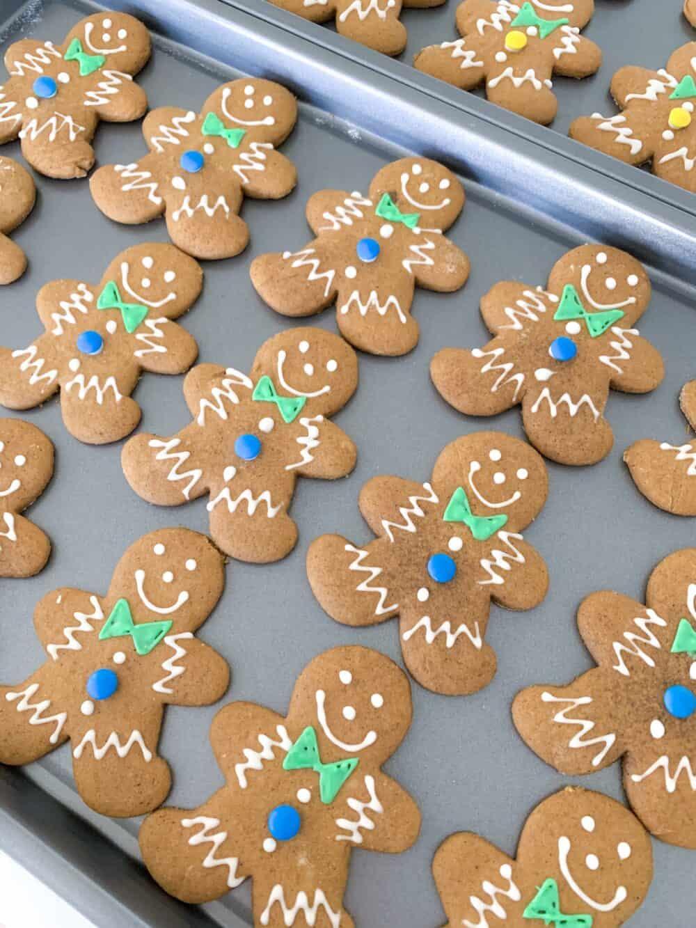iced gingerbread man cookies on baking sheet