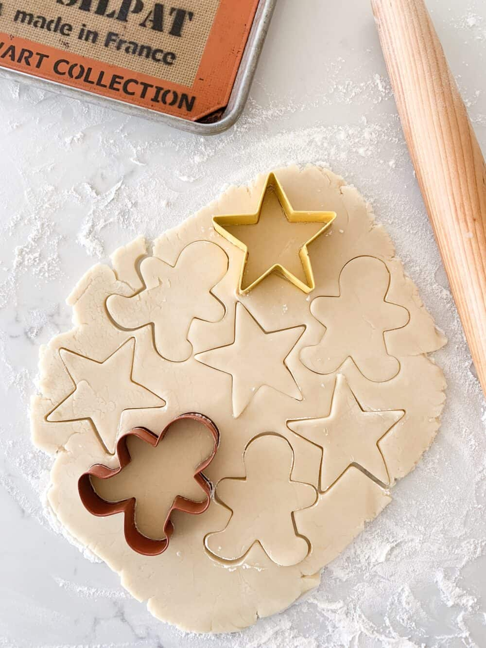 cookie cutters on top of sugar cookie dough