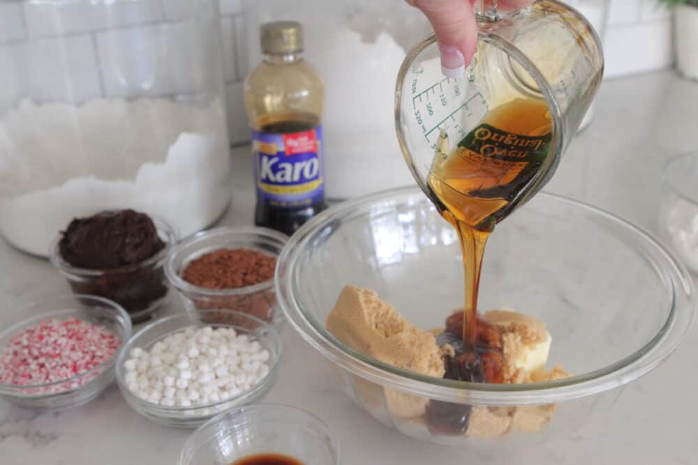 pouring Karo Syrup in mixing bowl for peppermint brownies