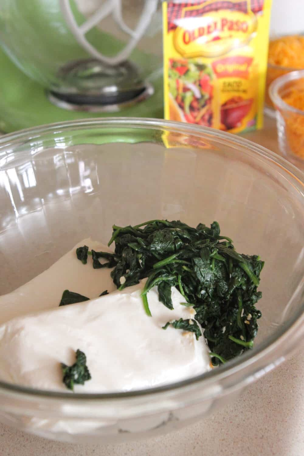 cream cheese and spinach in mixing bowl