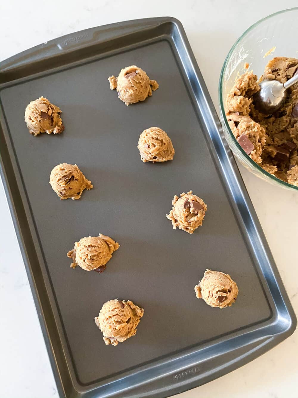 scooping brown butter cookie dough