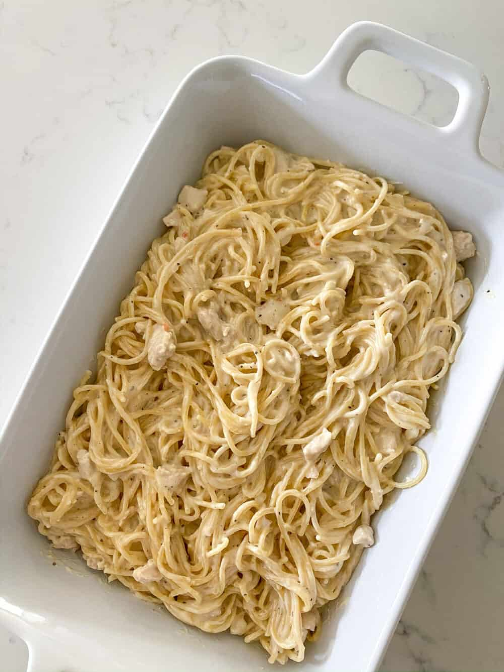 transfer pasta and sauce to baking dish