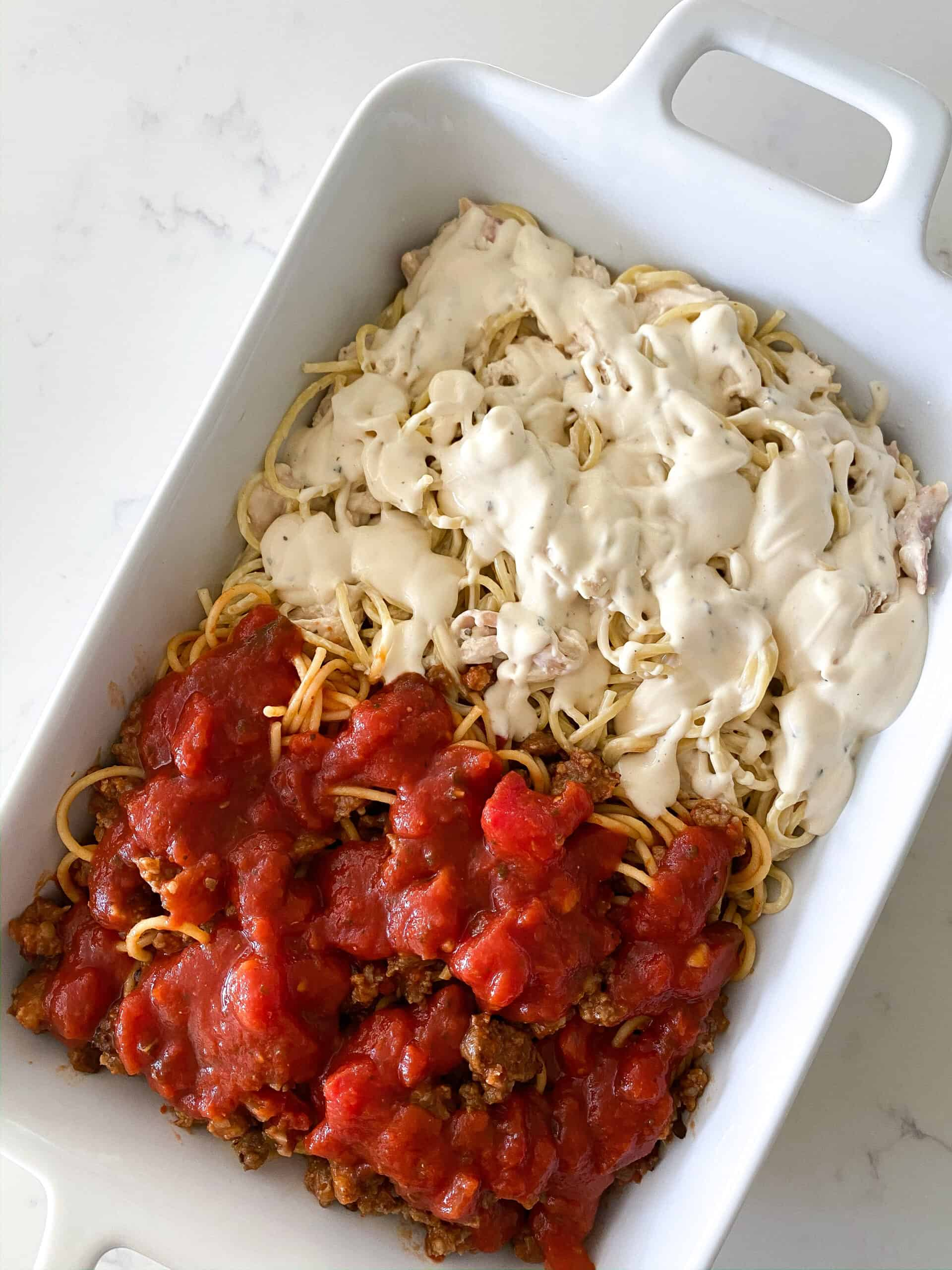 baked spaghetti in baking dish ready to bake