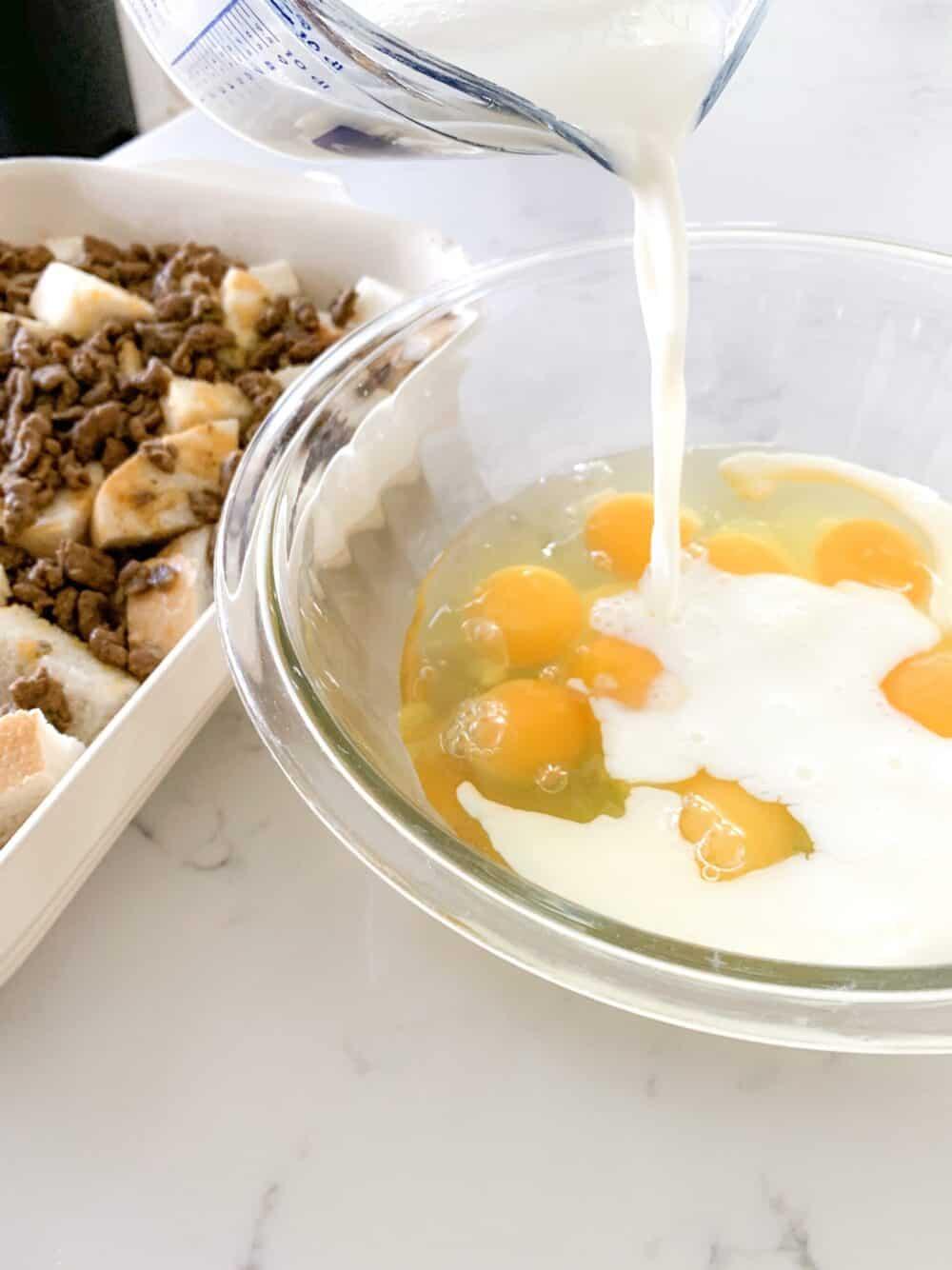 pouring milk into egg bowl