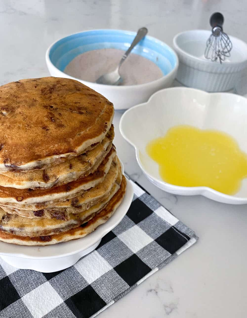 stack of pancakes ready to be brushed with melted butter