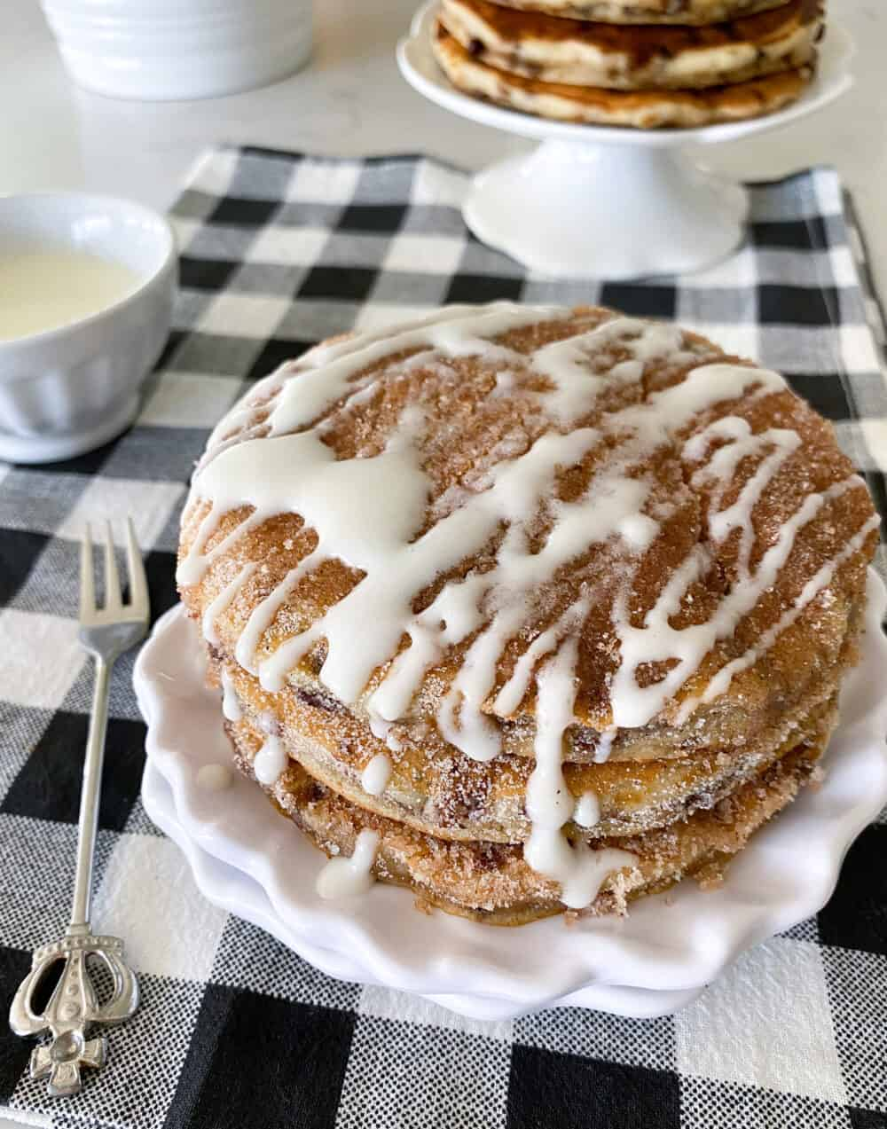 iced fluffy pancakes on serving plate