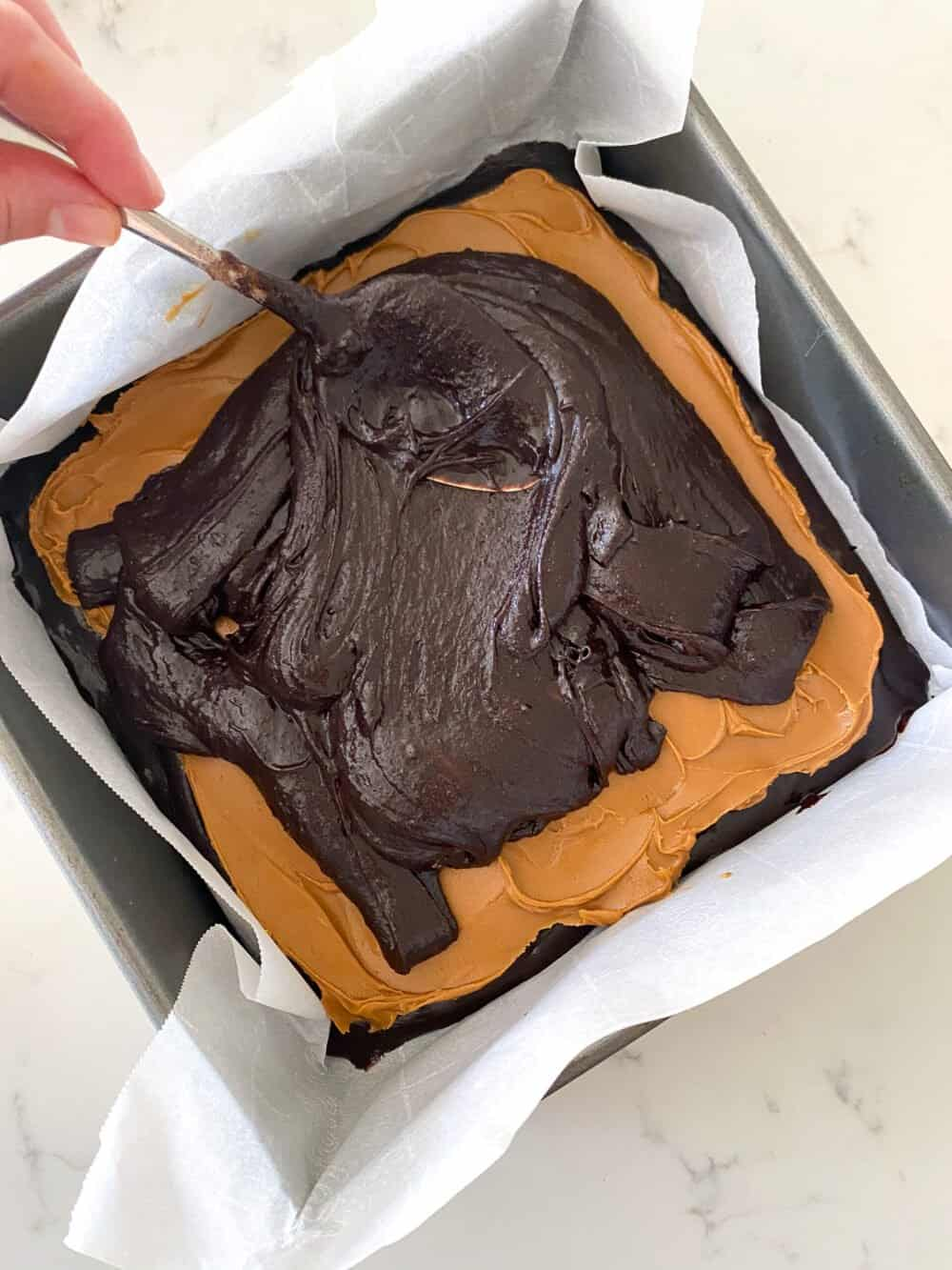 pour remaining brownie batter on top