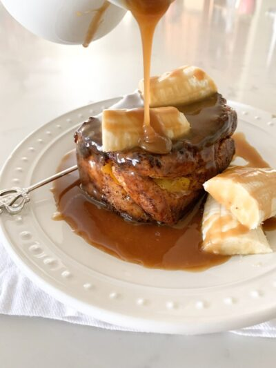pouring caramel over brioche french toast