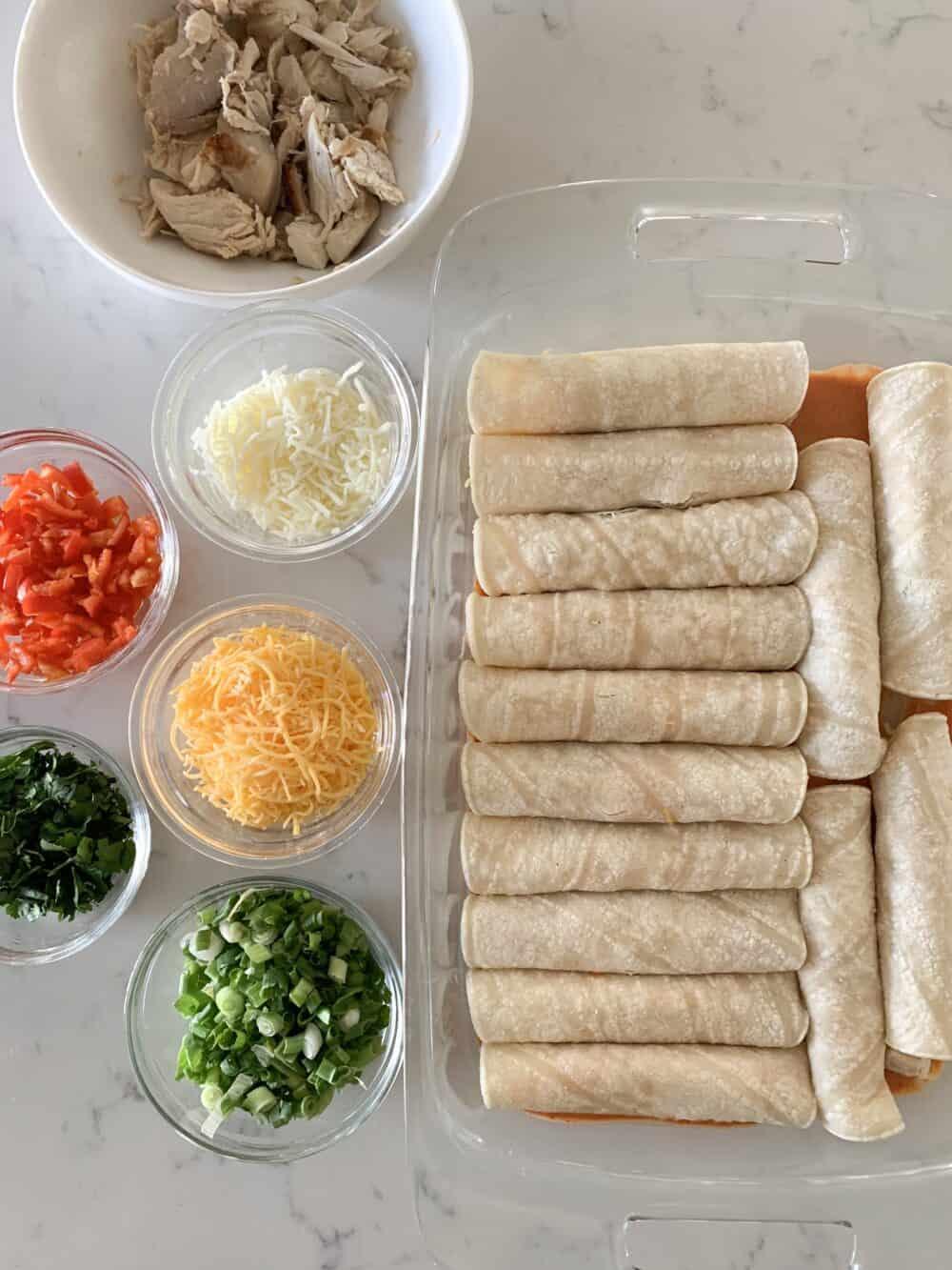 filled chicken enchiladas in pan