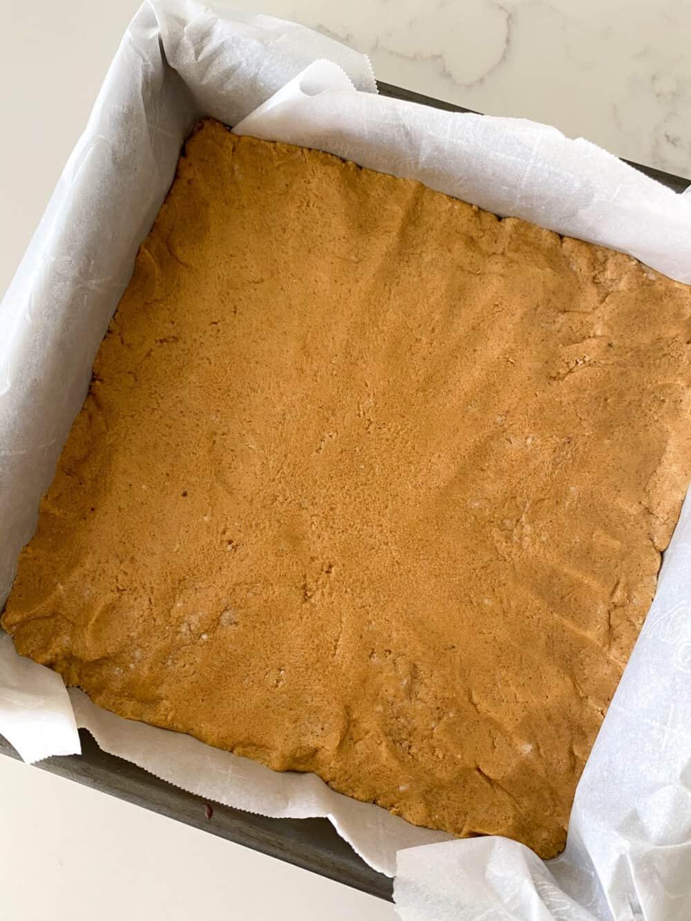 peanut butter bars dough pressed in pan