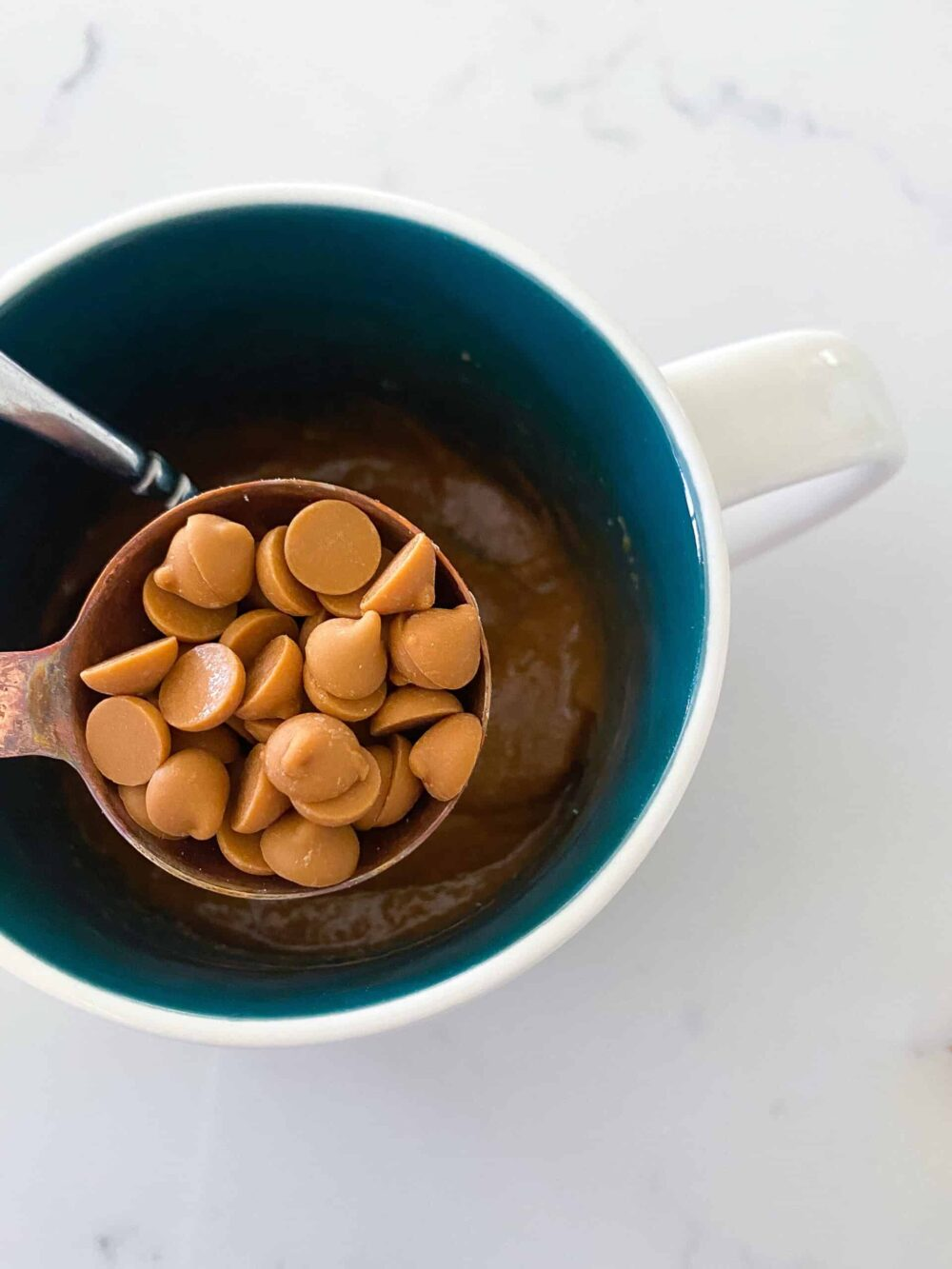 adding sugar free chocolate chips to mug