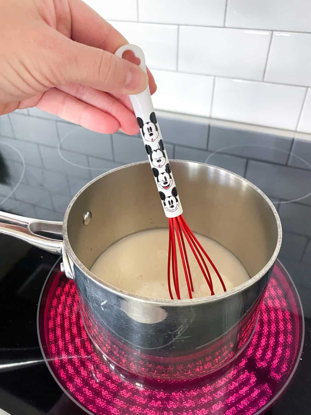 whisking chocolate in saucepan