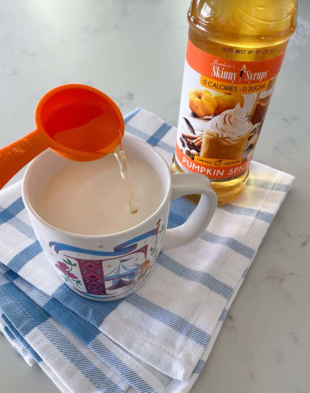 adding sugar free pumpkin spice syrup to keto hot chocolate