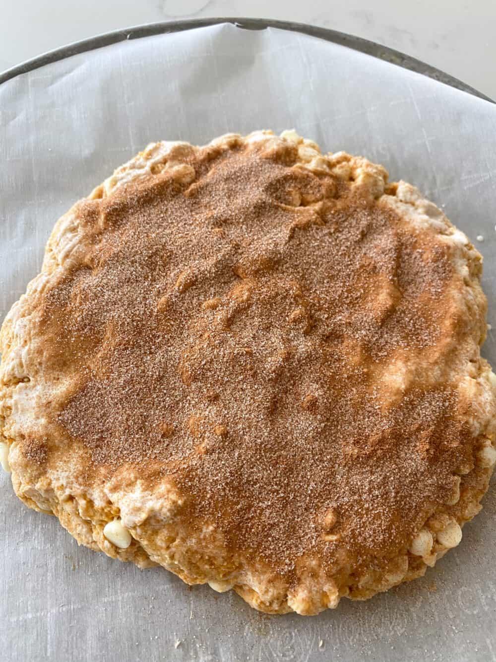 cinnamon sugar sprinkled on top of pumpkin scones
