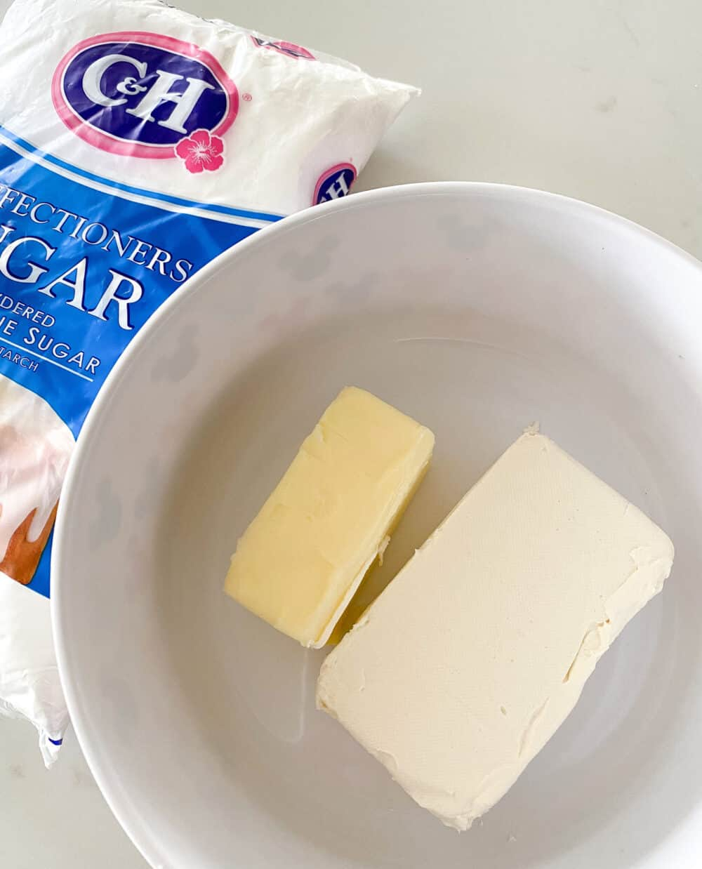 cream cheese and butter in mixing bowl