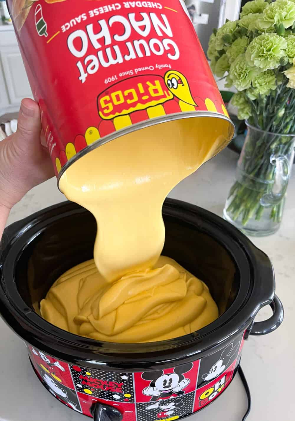 adding cheese to crockpot for queso recipe