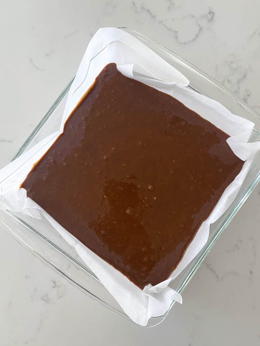 transferring gingerbread cake batter to baking dish