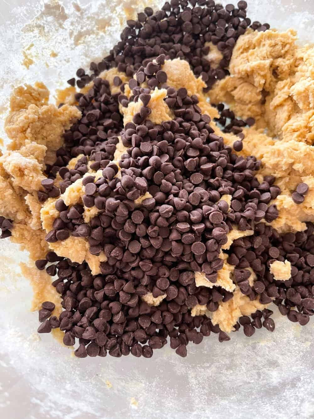 chocolate chips added to mixing bowl for cheesecake bars