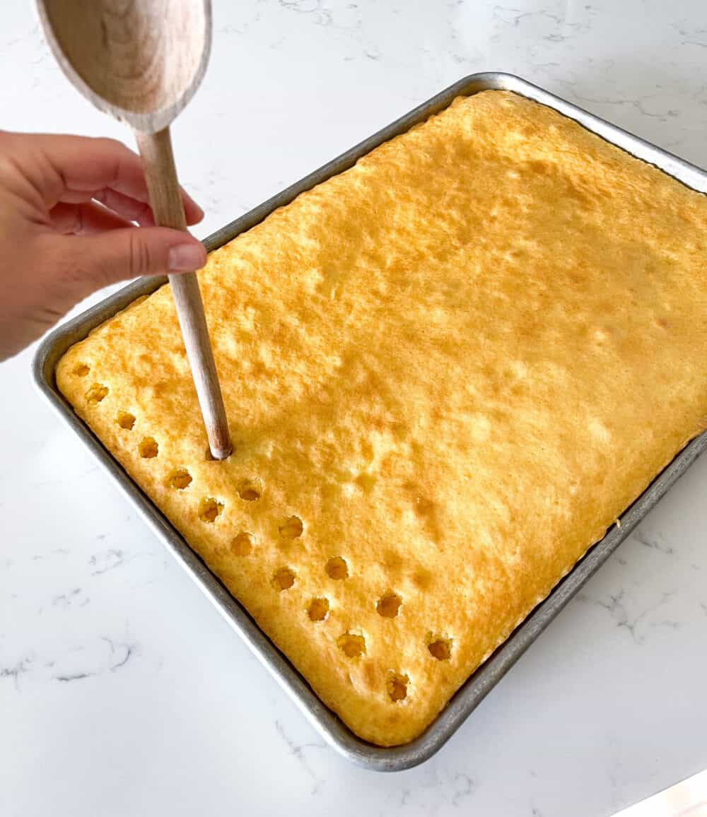 poking holes into top of sheet cake