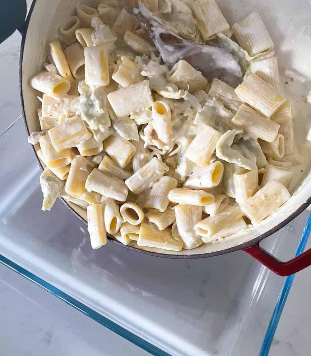 transferring pasta bake to baking pan