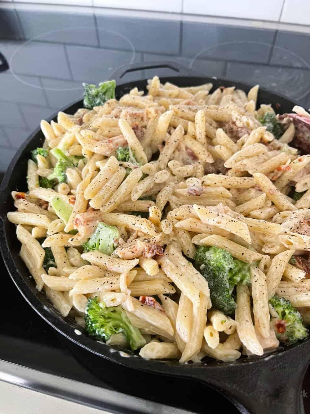 creamy chicken pasta in cast iron skillet