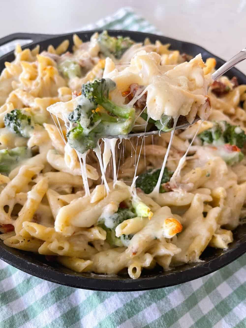 spooning up chicken pasta bake