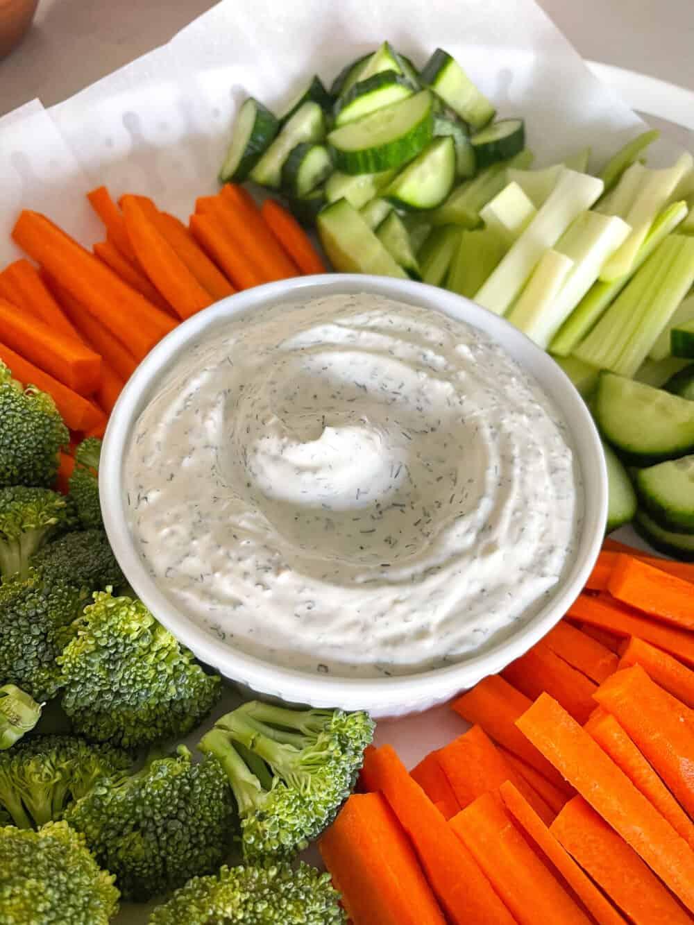veggie dip in bowl with vegetables to dip